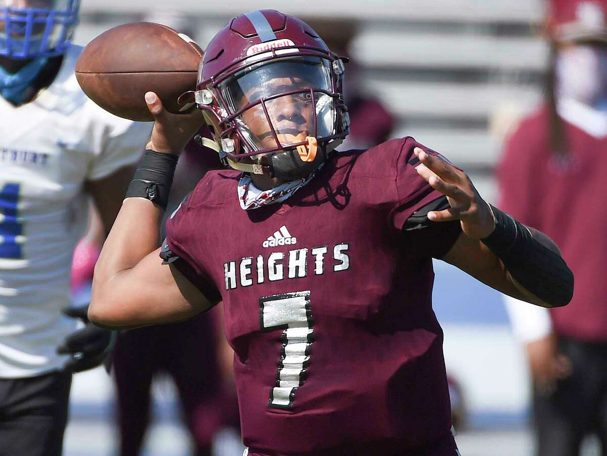 Heights quarterback Jalen Morrison (7) throws a pass during the first half of a high school football game against Westbury, Saturday, Oct. 10, 2020, in Houston.