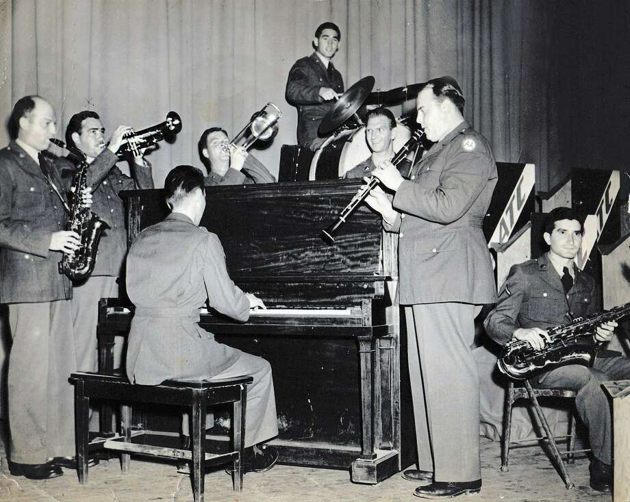 Lee Meredith is pictured left on trumpet in the Big Band at Camp Hulon in Palacios during World War II. Meredith went on to be a newsman, musician and teacher in Conroe. Photo: Courtesy Photo