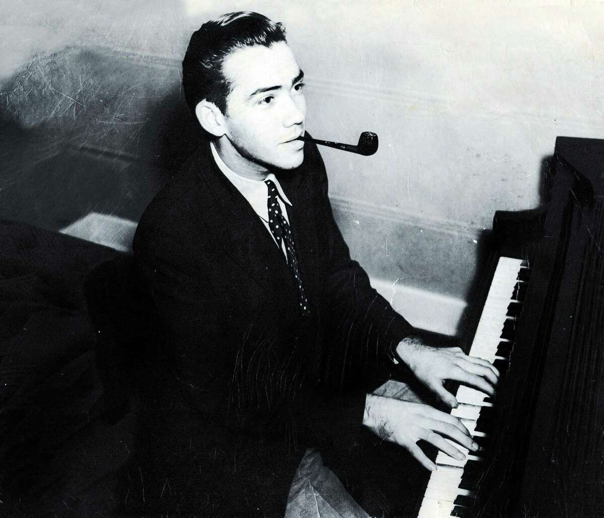 Lee Meredith behind the piano at a young ago. He was a arranger of Big Band music of considerable note.