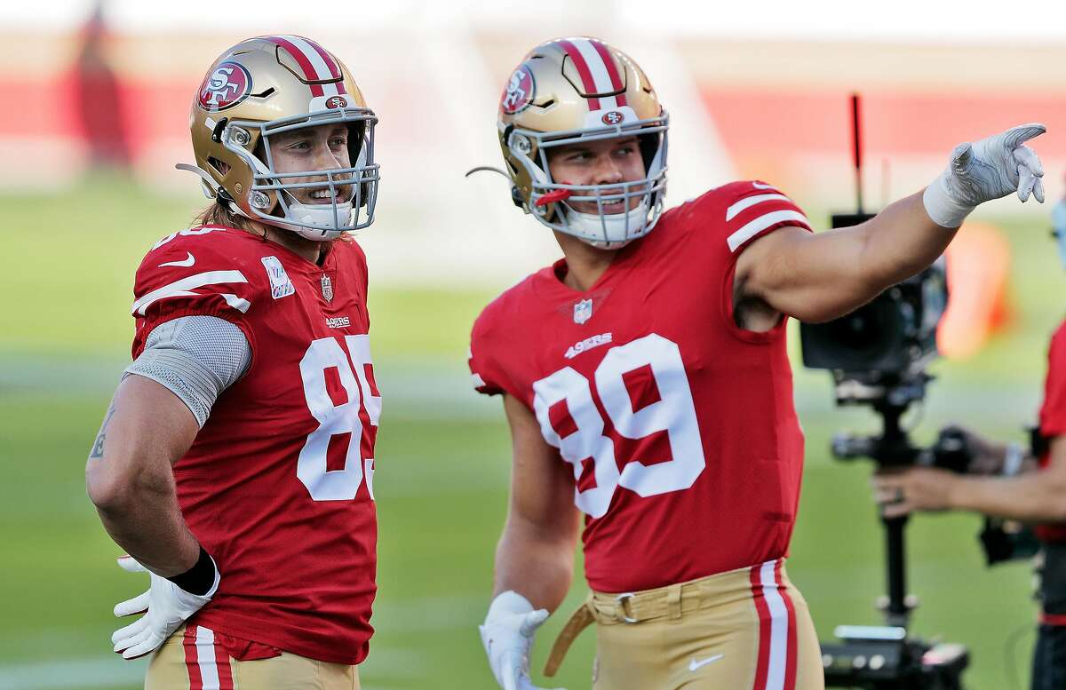 George Kittle (85) talks with fellow tight end Charlie Woerner before the 49ers' loss to Philadelphia on Oct. 4.