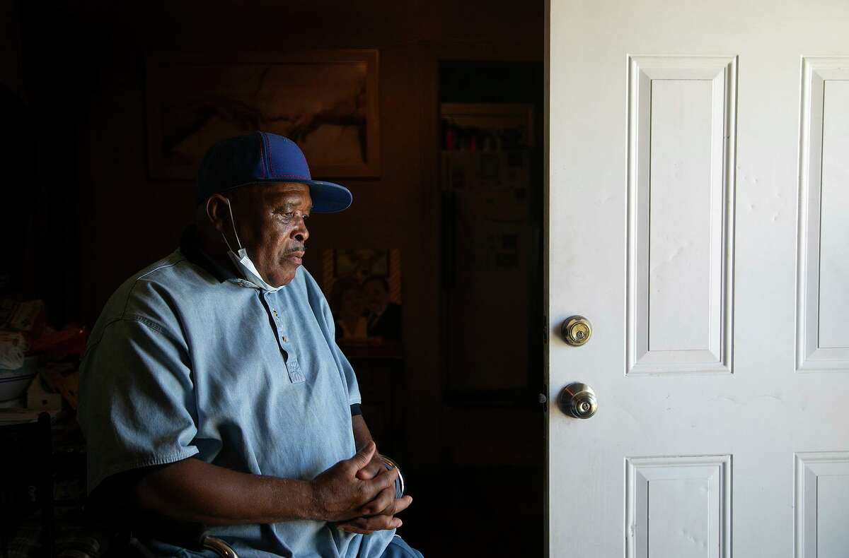 Eddie Wilson Sr. its in his walker Aug. 14 near the front door of the home he rents on the near East Side. In January, four San Antonio police officers barged into the house and beat his son, Eric Wilson, who they said was resisting arrest. Ten months later, the door still has dents in it.