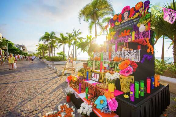 Altars with photos, candles and marigolds line the Malecón.