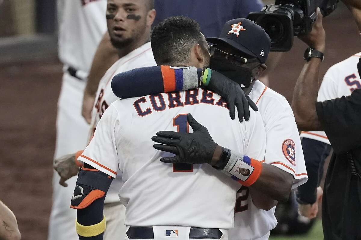Houston manager Dusty Baker, right, hugs Carlos Correa after his ALCS Game 5 walk-off home run last week.