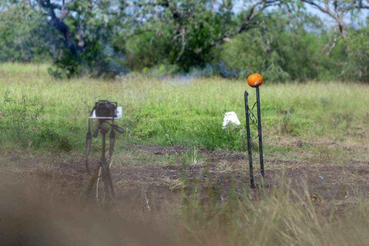 A fuse for a so-called cricket bomb burns Sept. 24, 2020 just before exploding in a pumpkin during filming near George West of an Ordnance Lab Youtube channel video by Texas Machine Gun & Ordnance.