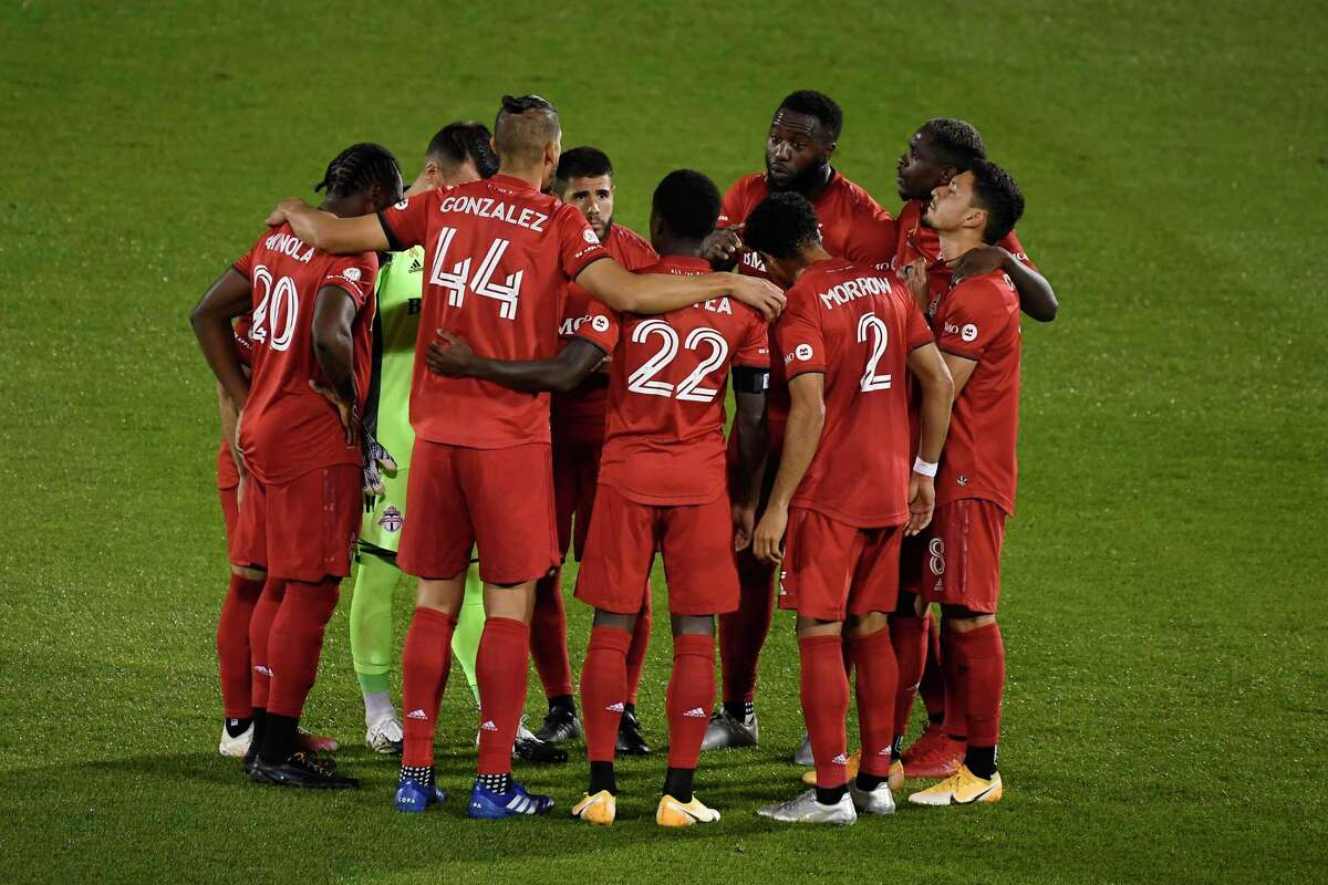 Toronto FC players huddle together before an MLS match against the Columbus Crew on Sept. 27 in East Hartford.