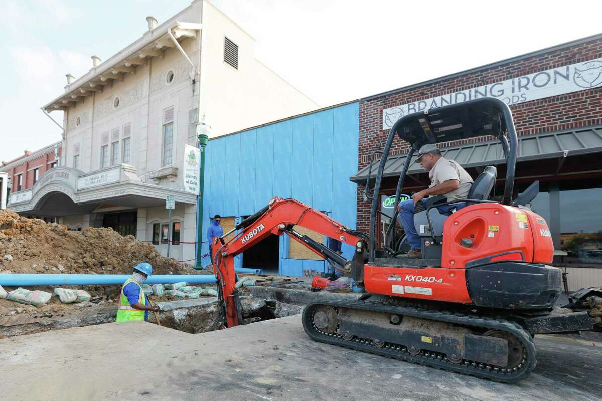 Construction workers put in a new fire water line for the Crighton Theater, Thursday, Oct. 15, 2020, in Conroe.