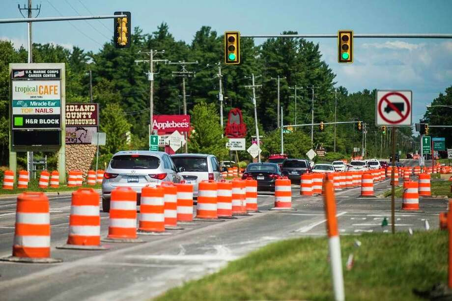 One lane of northbound traffic is blocked off as construction is underway along Eastman Avenue Thursday, Aug. 6, 2020 in Midland. (Katy Kildee/kkildee@mdn.net)