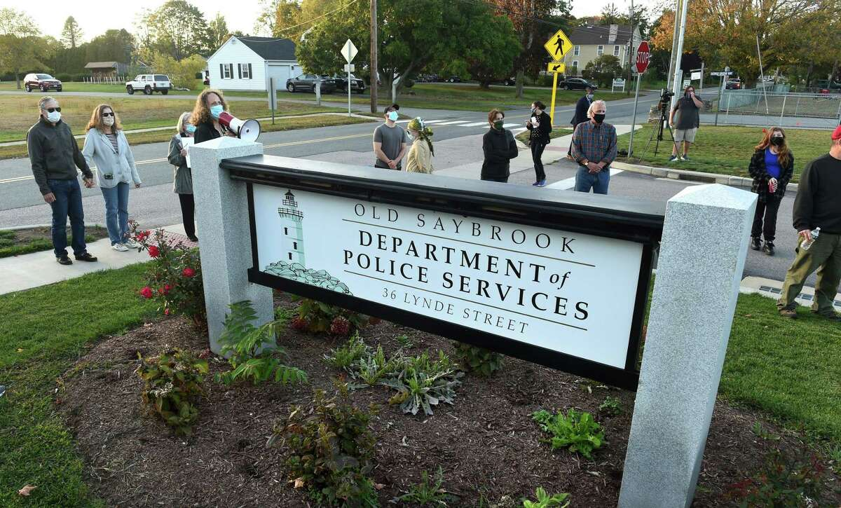 Area residents protest in front of the Old Saybrook Department of Police Services on October 15, 2020 concerning an incident involving the Old Saybrook Police Department and a resident with Down Syndrome.