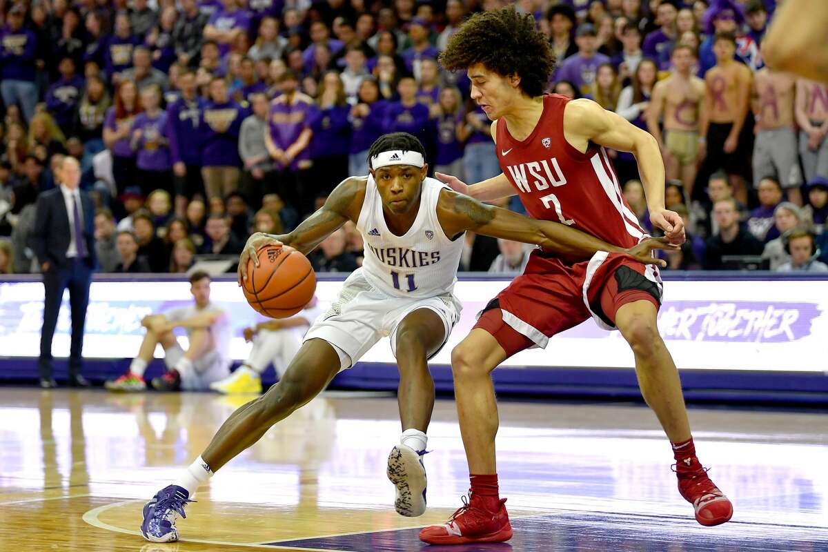 SEATTLE, WASHINGTON - FEBRUARY 28: Nahziah Carter #11 of the Washington Huskies handles the ball against CJ Elleby #2 of the Washington State Cougars during the first half of the game at the Alaska Airlines Arena at Hec Edmundson Pavilion on February 28, 2020 in Seattle, Washington. The WSU Cougars topped the UW Huskies, 78-74. (Photo by Alika Jenner/Getty Images)