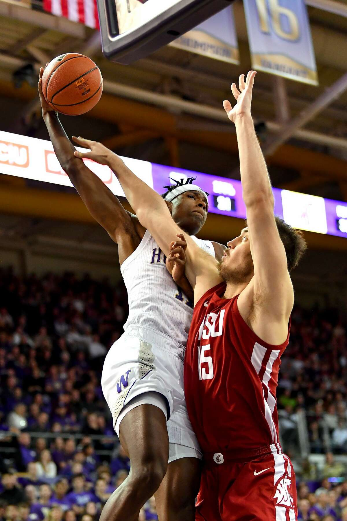 SEATTLE, WASHINGTON - FEBRUARY 28: Nahziah Carter #11 of the Washington Huskies elevates to the basket against Volodymyr Markovetskyy #15 of the Washington State Cougars during the second half of the game at the Alaska Airlines Arena at Hec Edmundson Pavilion on February 28, 2020 in Seattle, Washington. The WSU Cougars topped the UW Huskies, 78-74. (Photo by Alika Jenner/Getty Images)