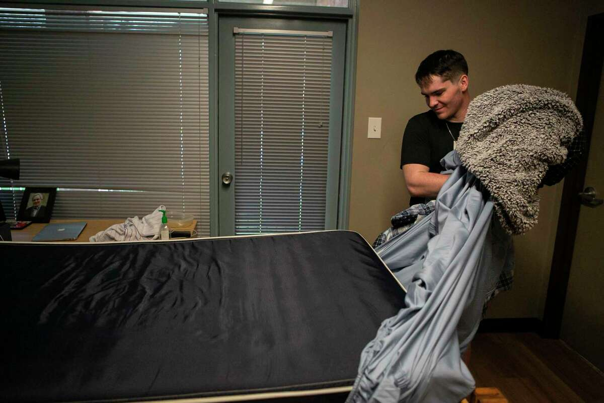 Colin Conway, 21, of Houston strips his bed as he moves out of his Trinity University residence hall last March. The city's private universities saw declines in enrollment in the fall, though not as bad as predicted nationally.