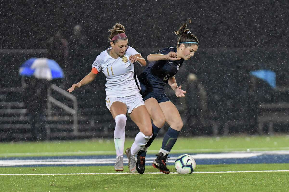 Maddie Fried (11) of the St. Joseph Cadets and Gabriella Gonzalez (15) of the Staples Wreckers battle for ball control during the FCIAC Girls Soccer Championship on Thursday Nov 7, 2019 at Wilton High School in Wilton, Connecticut.