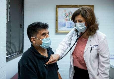 Dr. Forough Farizani examines patient Khaleel Yoisif at Hillcroft Clinic on Thursday, Oct. 15, 2020, in Houston.