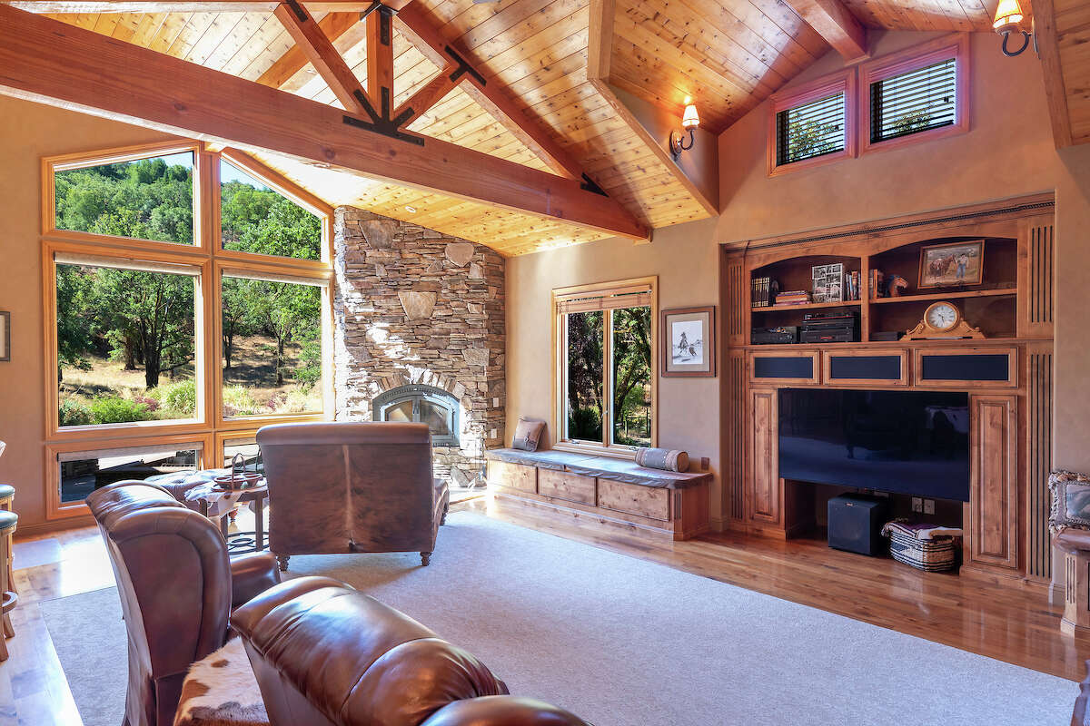 Floor to ceiling windows overlook the vast, Oak studded property.