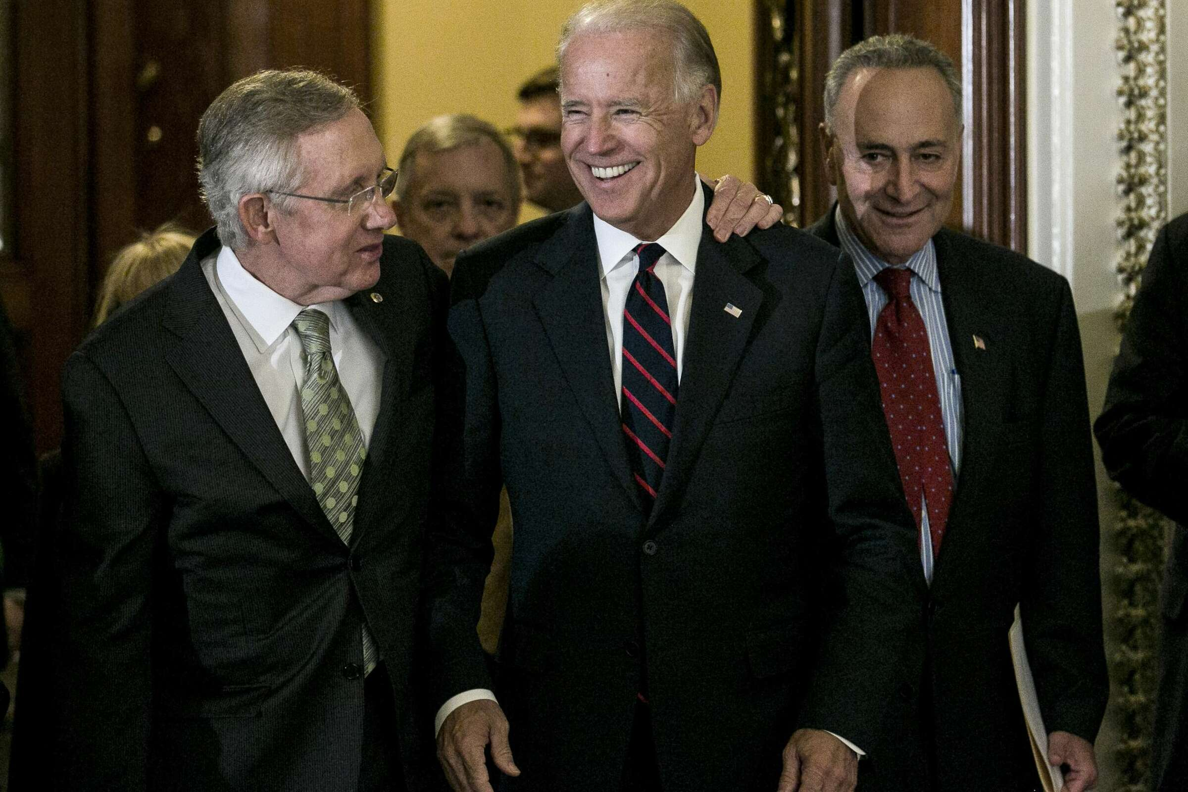 Senators Harry Reid, Joe Biden, and Chuck Schumer walking together