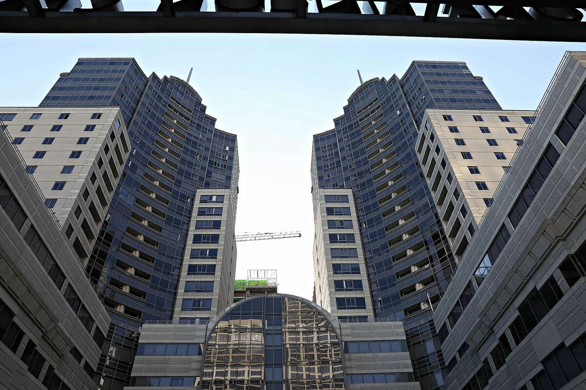 A portion of Two Rincon Center in San Francisco is seen flanked by two taller buildings. Google has space there and is leasing an additional 42,000 square feet.