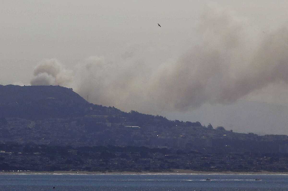A large plume of smoke is seen from a wildfire on San Bruno Mountain in South San Francisco Friday.