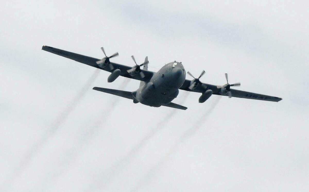In this file photo, a C-130 Hercules military transport aircraft from Connecticut Air National Guard's 103rd Airlift Wing Flying Yankees flies over the helipad at Stamford Hospital in Stamford, Conn. Thursday, May 14, 2020.