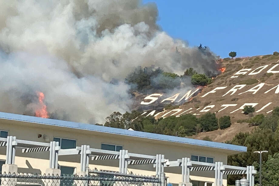 Firefighters are battling a four-alarm grass fire Friday afternoon on San Bruno Mountain in South San Francisco. Photo: Courtesy Of Russ Gold Photo