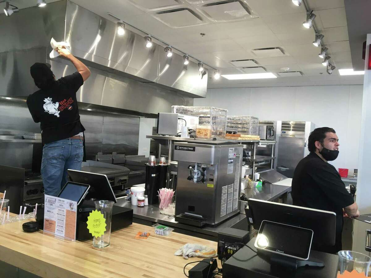 Bunz Handcrafted Burgers has an open kitchen that greets customers upon entry.