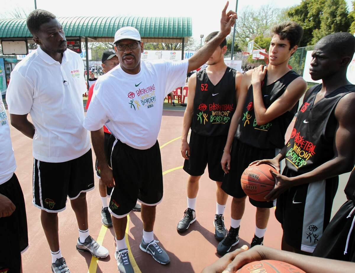 Rockets scout Brent Johnson (center), speaking here in 2013 with the Bulls' Luol Deng during the Basketball Without Borders program in Johannesburg, South Africa, died Thursday. He had been with the Rockets since the 1994-95 season.