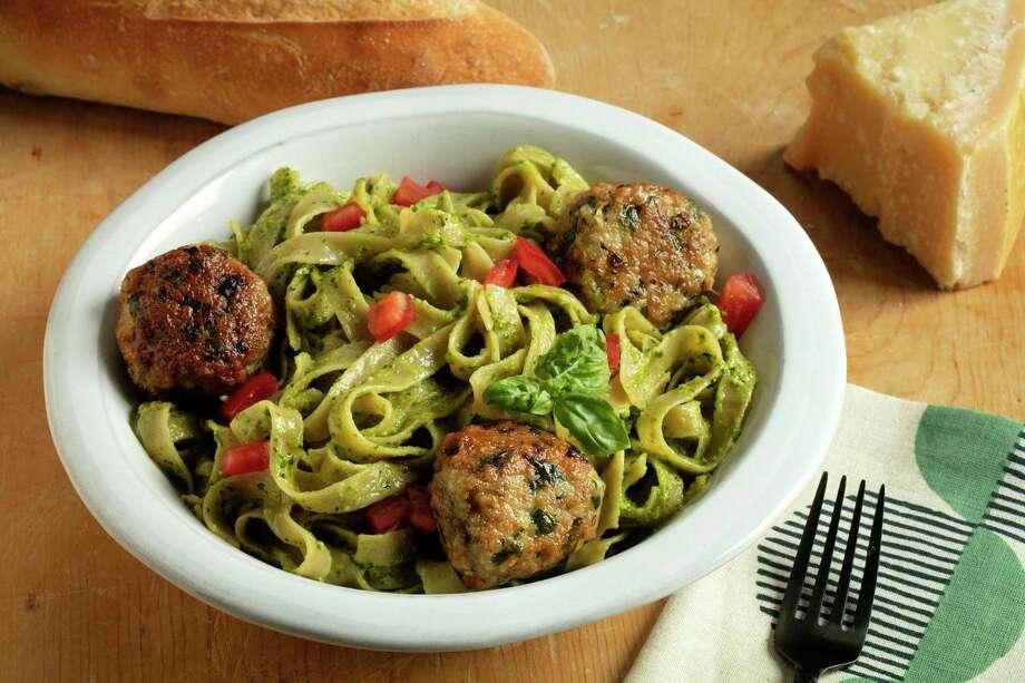 Fettucine with cilantro-almond pesto and chicken meatballs. (E. Jason Wambsgans/TNS) / Chicago Tribune