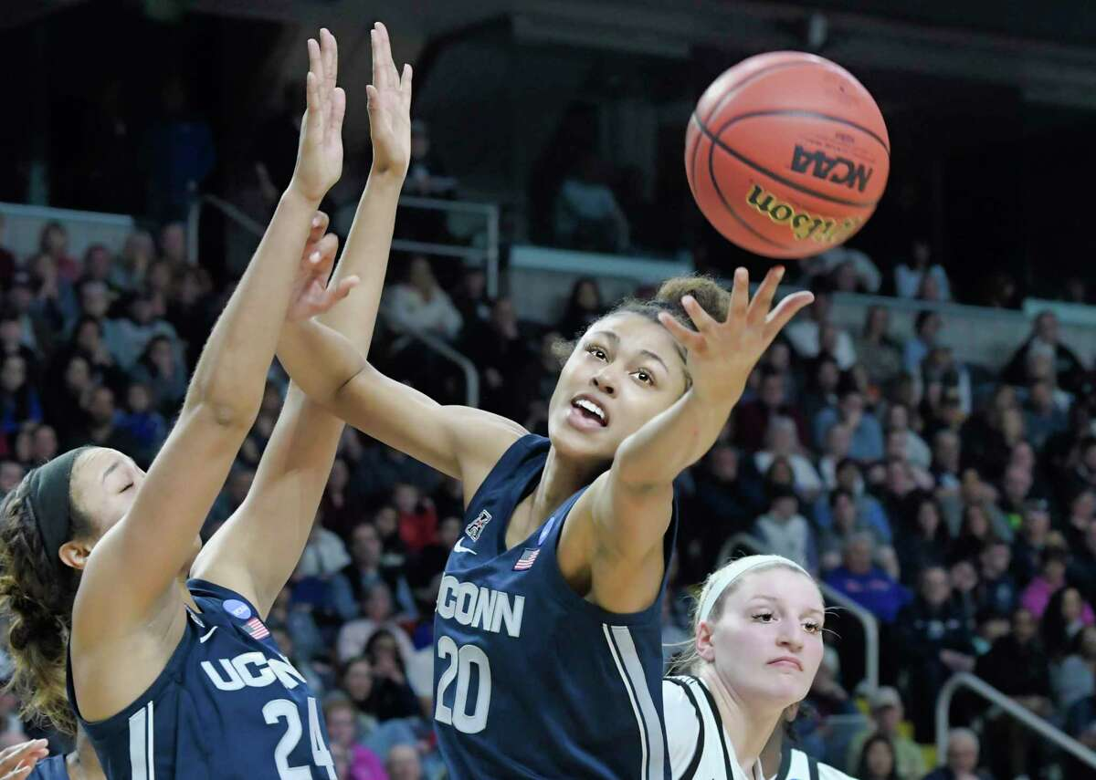 UConn's Olivia Nelson-Ododa reaches out for a rebound during their game against Louisville in the final of the Albany Regional on March 31.