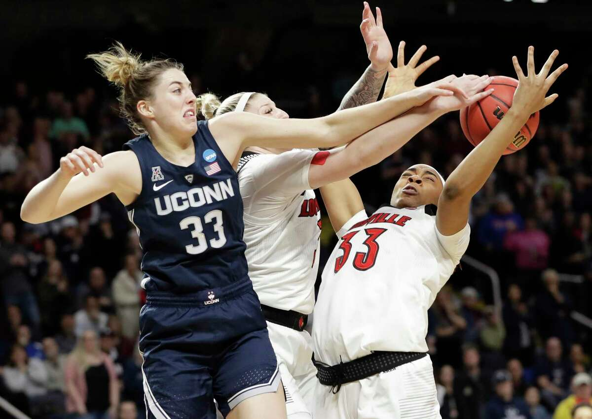 UConn guard Katie Lou Samuelson (33) knocks the ball from Louisville forward Sam Fuehring, center, and Louisville forward Bionca Dunham (33) during their regional championship final in the NCAA Tournament on March 31, 2019.