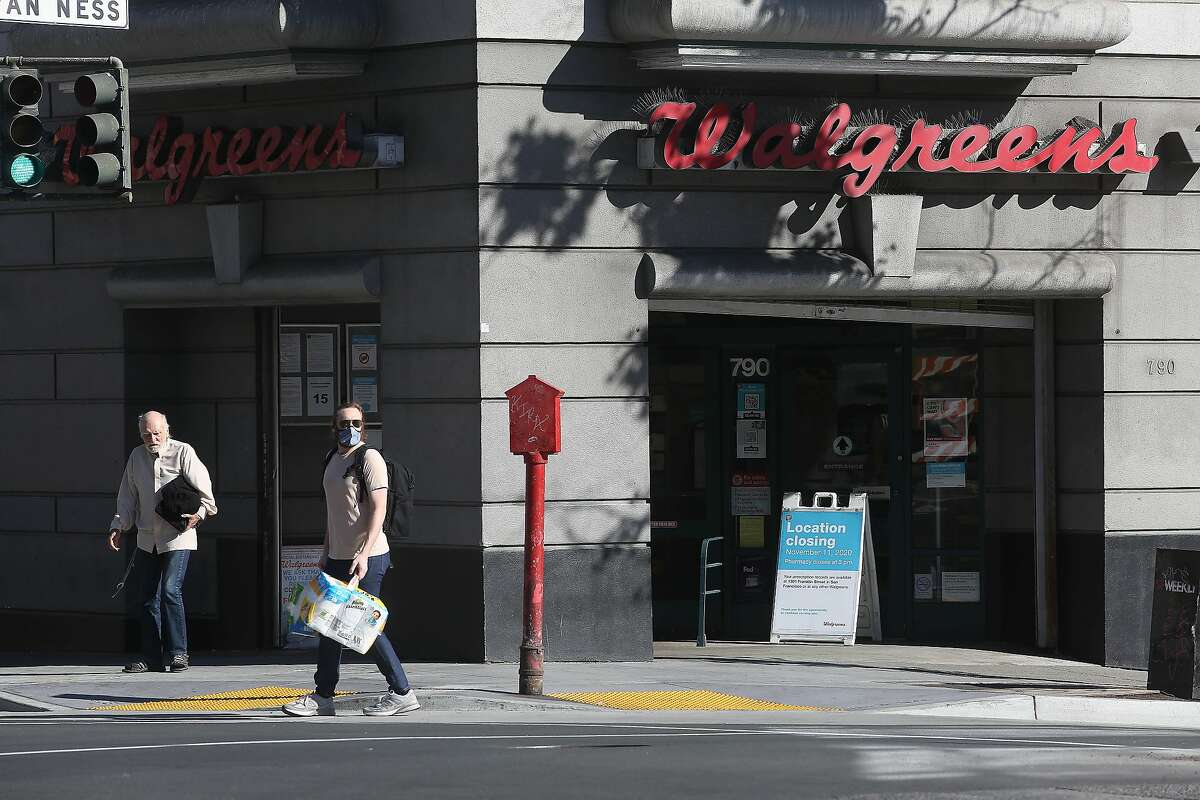 Pedestrains walk past the Walgreens on the corner of Van Ness Avenue and Eddy Street on Monday, October 12, 2020 in San Francisco, Calif. The Walgreens at 790 Van Ness Avenue is scheduled to close on November 11.