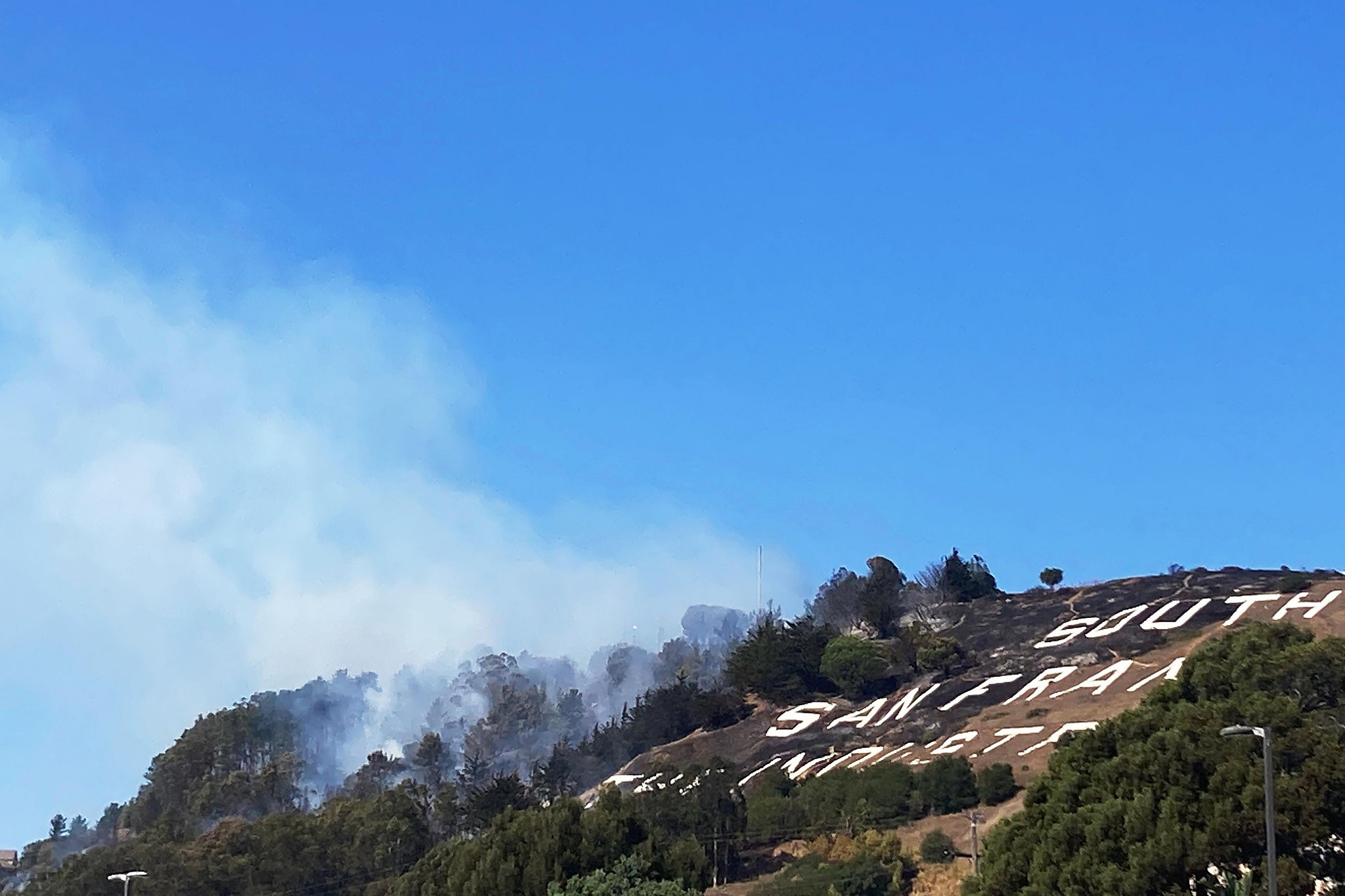 Evacuations ordered as fire burns near South S.F.'s Hillside Sign