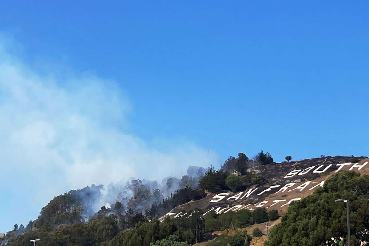 A four-alarm vegetation fire was burning on South San Francisco's iconic Sign Hill Friday afternoon. Mandatory evacuations were put in place for Carnelian Road, Sonja Road, Mountain Road, Ridgeview Court and Viewmont Terrance, according to the South San Francisco Fire Department.