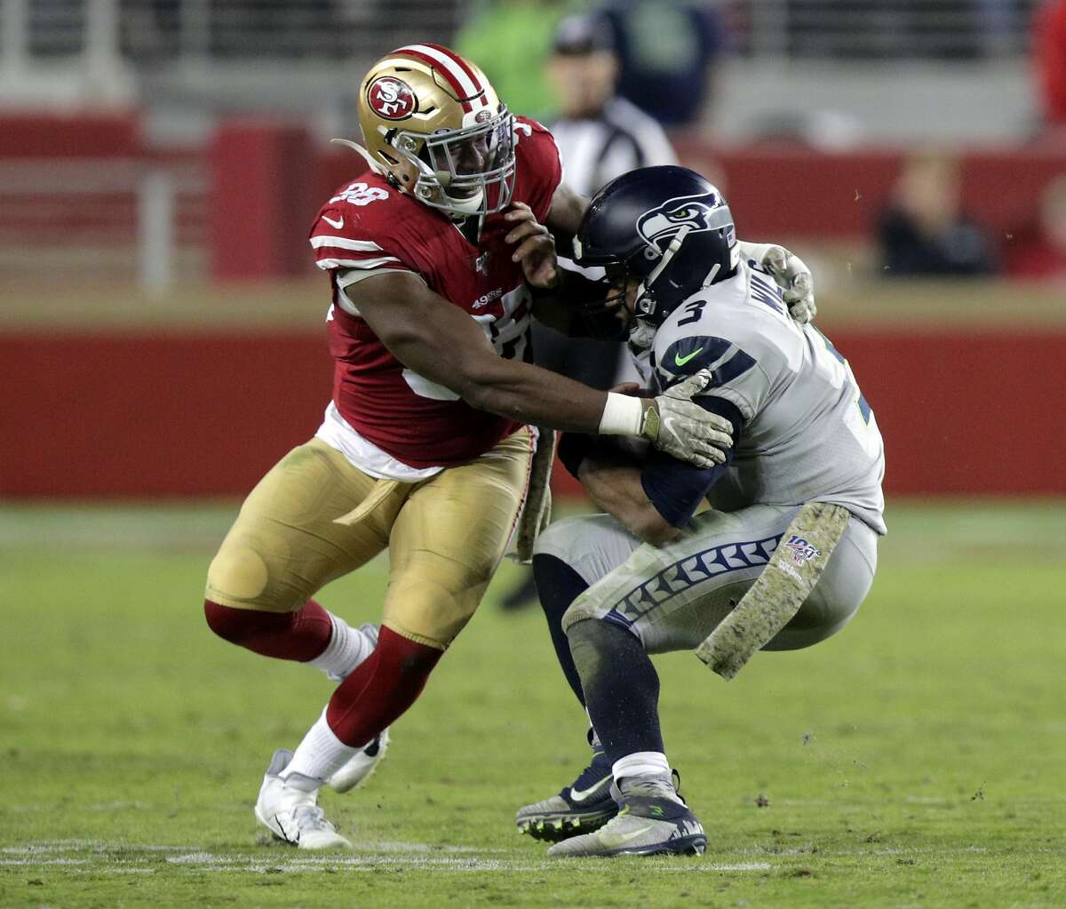 Ronald Blair (98) sacks Russell Wilson (3) in the second half as the San Francisco 49ers played the Seattle Seahawks at Levi's Stadium in Santa Clara, Calif., on Monday, November 11/11/19, 2019. The Seahawks came back to win 27-24 to give the 49ers their first loss of the season