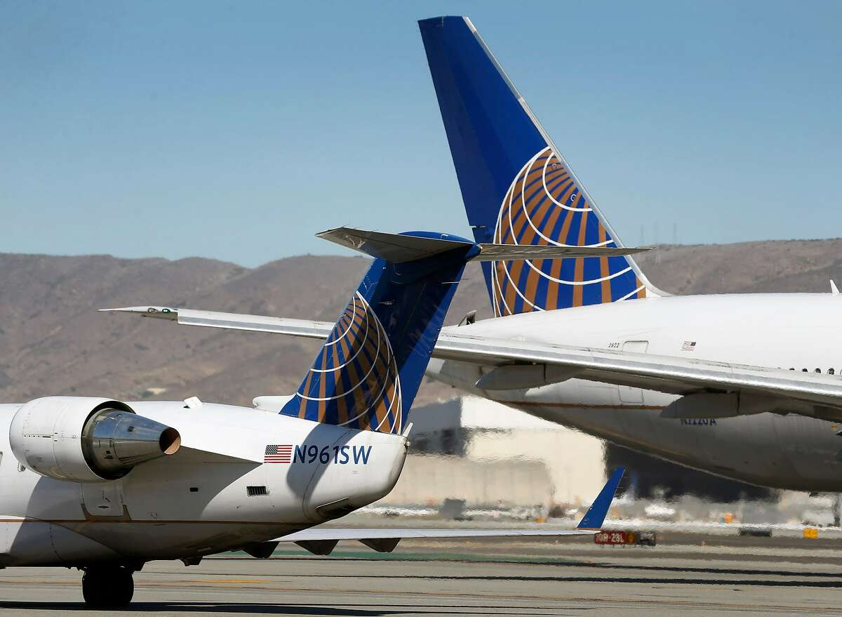 United Airlines planes pass each other at SFO in San Francisco, Calif. on Thursday, Oct. 15, 2020. As the airline industry sees a modest rise in travel, a rapid COVID-19 testing site has been set up at the airport to provide travelers with documentation of test results to present upon arrival at their final destinations.