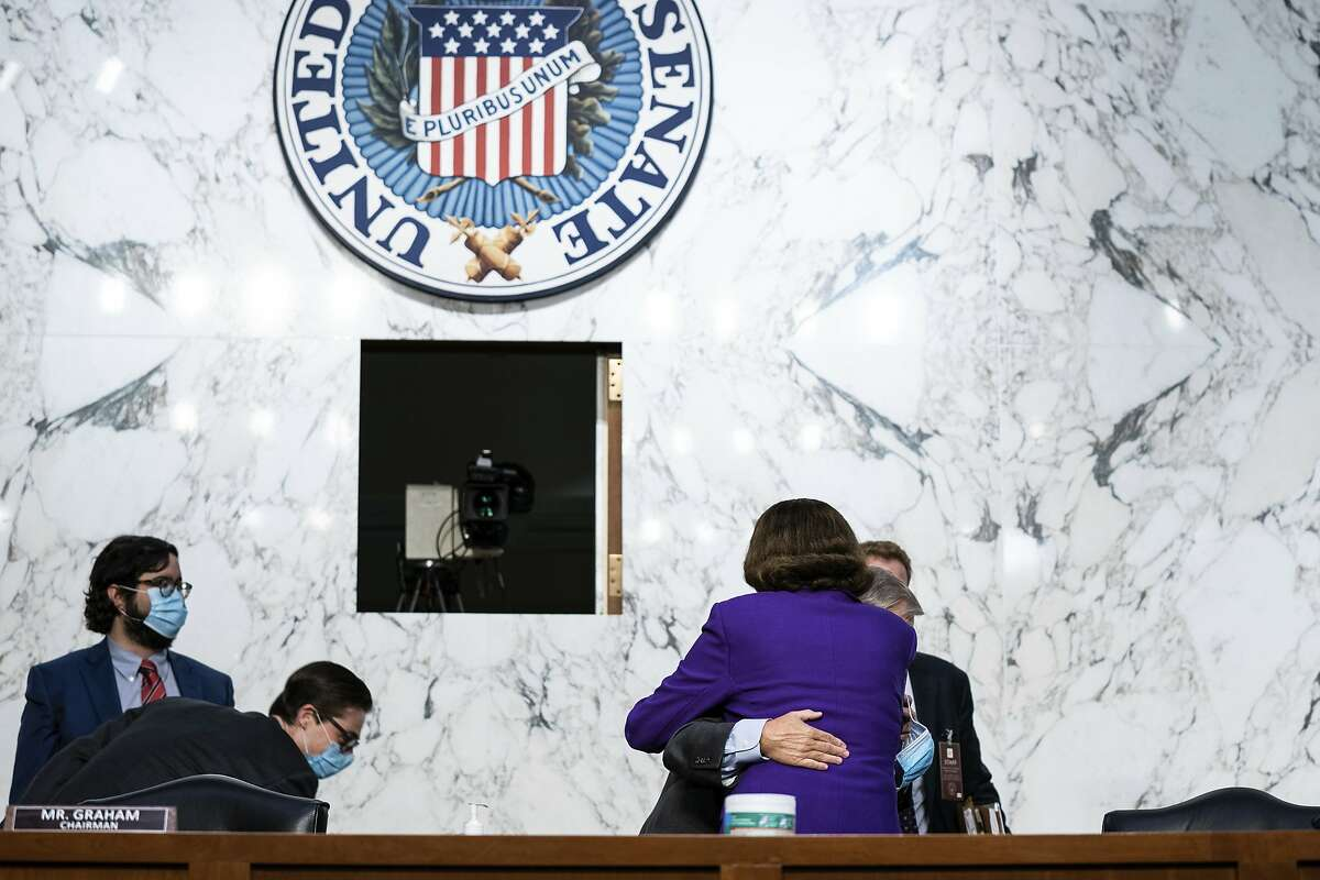 """Sens. Dianne Feinstein and Lindsey Graham hug on Thursday. Feinstein thanked him for """"one of the best set of hearings that I've participated in."""""""