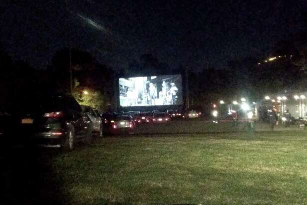 Cars line up to see the latest Netflix movie at a drive-in movie theater in Queens, New York.