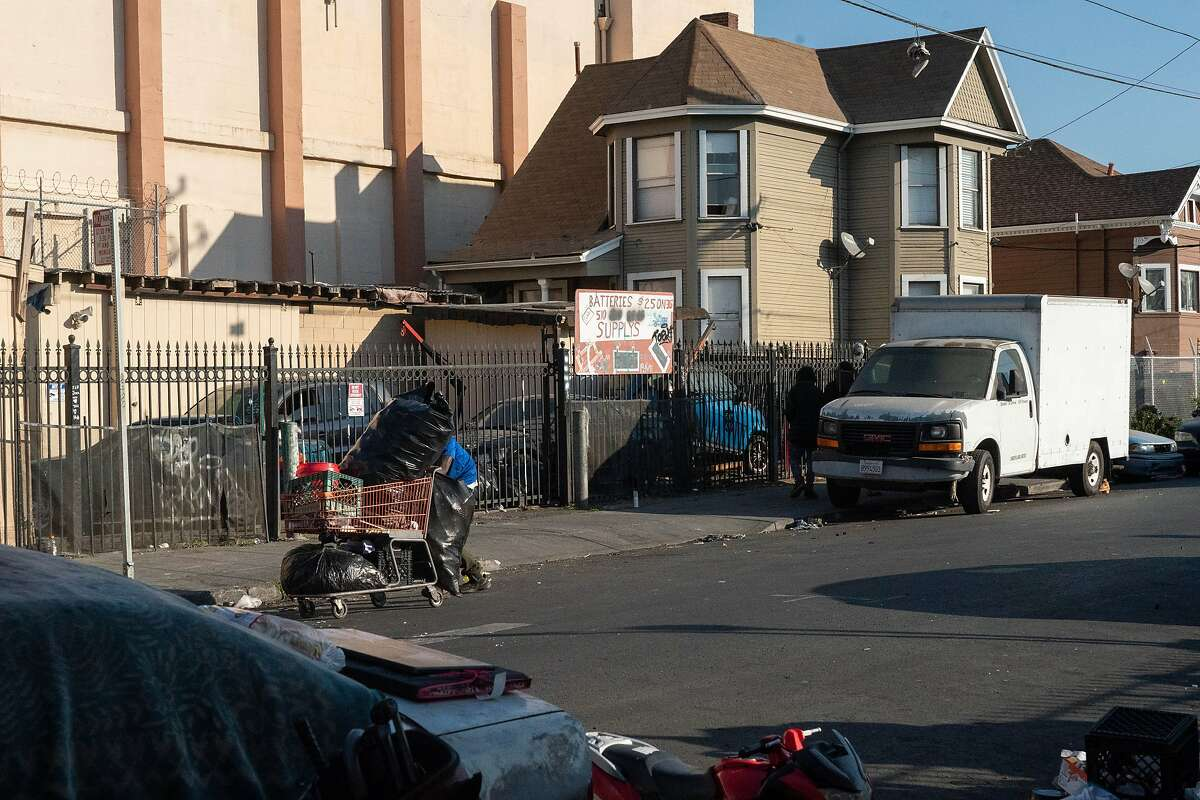 At left in front of the white truck is where a 39-year-old man was killed and two other people were wounded in a shooting Thursday night on the 1400 block of 89th Avenue in Oakland.