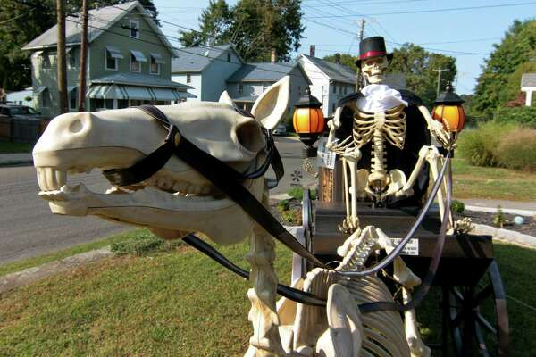A view of a Halloween display in front of a home on Hawkins Street in Derby, Conn., on Tuesday Sept. 22, 2020.