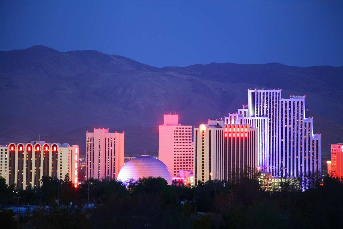 Reno Nevada downtown skyline glittering at night. Reno is a city in the US state of Nevada near Lake Tahoe. Known as