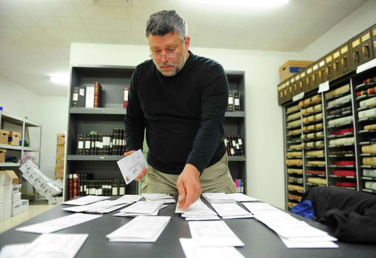 Derby City/Town Clerk Marc Garofalo, who also spent eight years as the city's mayor, urges people to request and return their Absentee Ballots early. Here he is shown sorting through dozens of absentee ballots at Derby City Hall during the 2016 Presidential election.