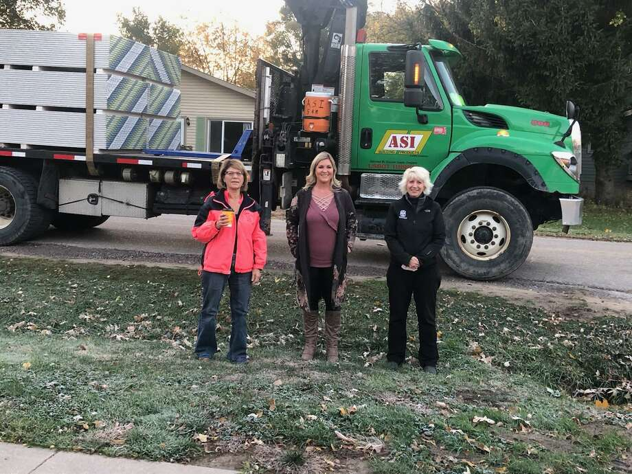 From left, Village of Sanford President Dolores Porte, Sanford Strong leader Teresa Quintana and State Rep. Annette Glenn helped coordinate the purchase, delivery and distribution of 500 sheets of drywall to Sanford area residents who are rebuilding their homes after the dam failures in May. Photo: Photo Provided/Teresa Quintana