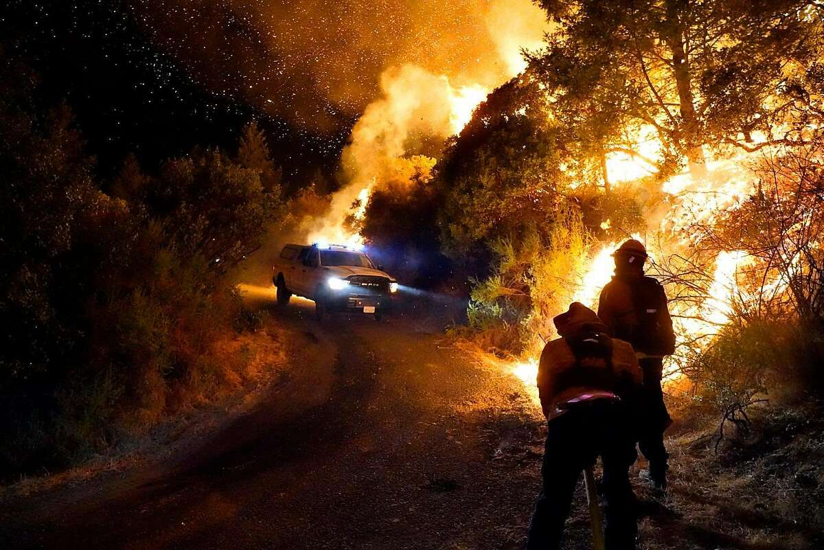 Firefighters battle the Glass Fire in Calistoga in September.