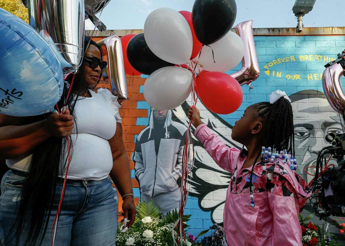 Gianna Floyd, center, releases balloons during a ceremony for what would have been her father's, George Floyd, 47th birthday in Third Ward on Wednesday, Oct. 14, 2020, in Houston.