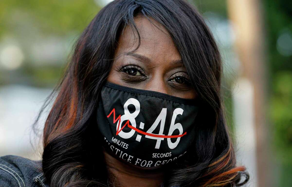 Tera Brown wears a face mask with the time a Minneapolis Police officer knelt on her cousin's, George Floyd, neck, during a balloon release ceremony celebrating Floyd's birthday Wednesday, Oct. 14, 2020, in Houston.