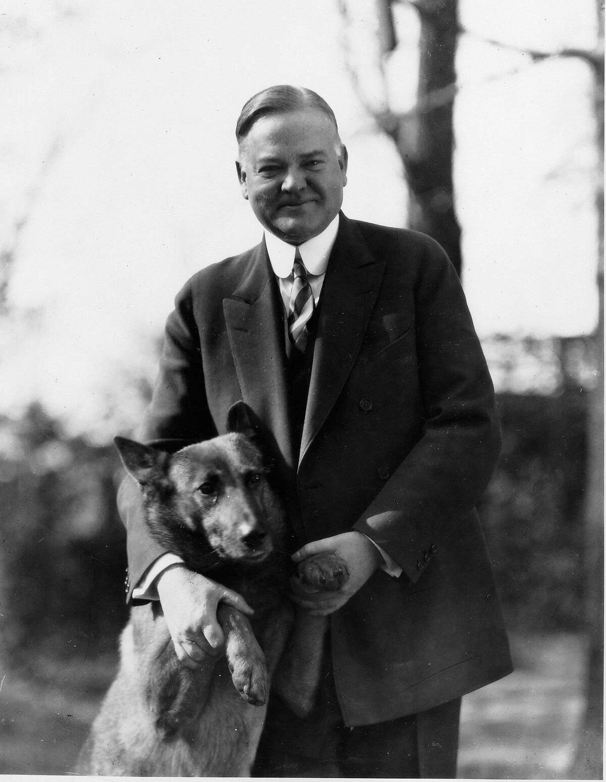 President Herbert Hoover poses with his police dog, King Tut, in this undated photo. Supporters of the Depression-era president born in West Branch, Iowa, say they are growing tired of the negative attacks on a man they say was perhaps the greatest humanitarian of the 20th century. The Democrats say it over and over again and, each time, the folks in West Branch wince: President Bush is the first since Herbert Hoover to lose jobs on his watch. (AP Photo/Hoover Library)