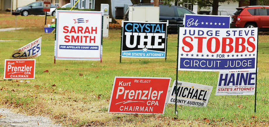Sign, sign, everywhere a sign as the song goes, at least that's what mororists on Humbert Road near Tolle Lane were seeing this week. Early voting expands in Madison County on Monday including voting at the Scott Bibbs Center on the corner of Central Avenue and East 5th Street in Alton.