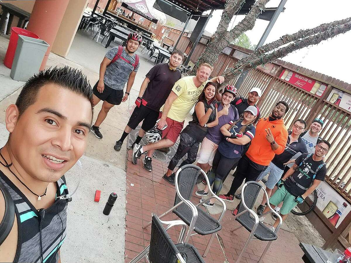 In this photo from before the pandemic, Martin Serrano, left, and some of his club members relax following one of their club rides. The club is expanding and looking for others who might want to join them for fun and a little exercise.