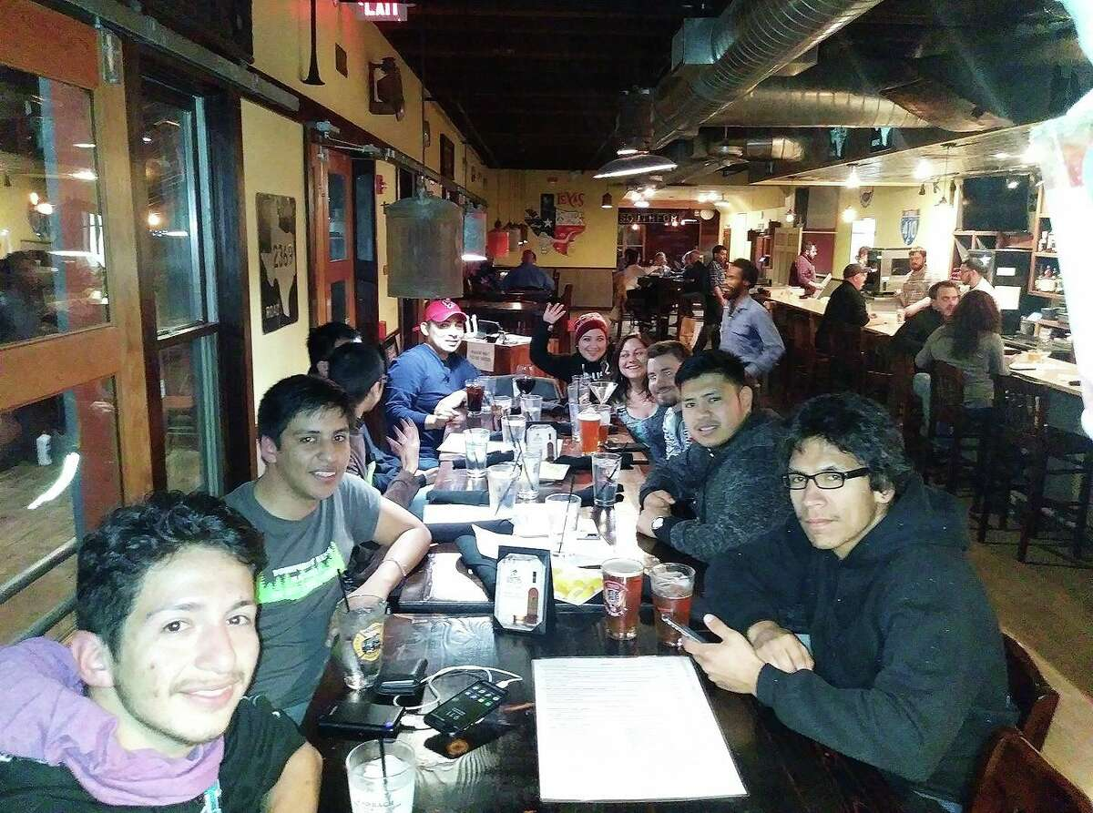 The club shares fun times over a meal in this photo from before the pandemic, and sometimes a trip to the Renaissance Festival or a swim party. To join them, look for them on Facebook under Cypress Cycle Club.