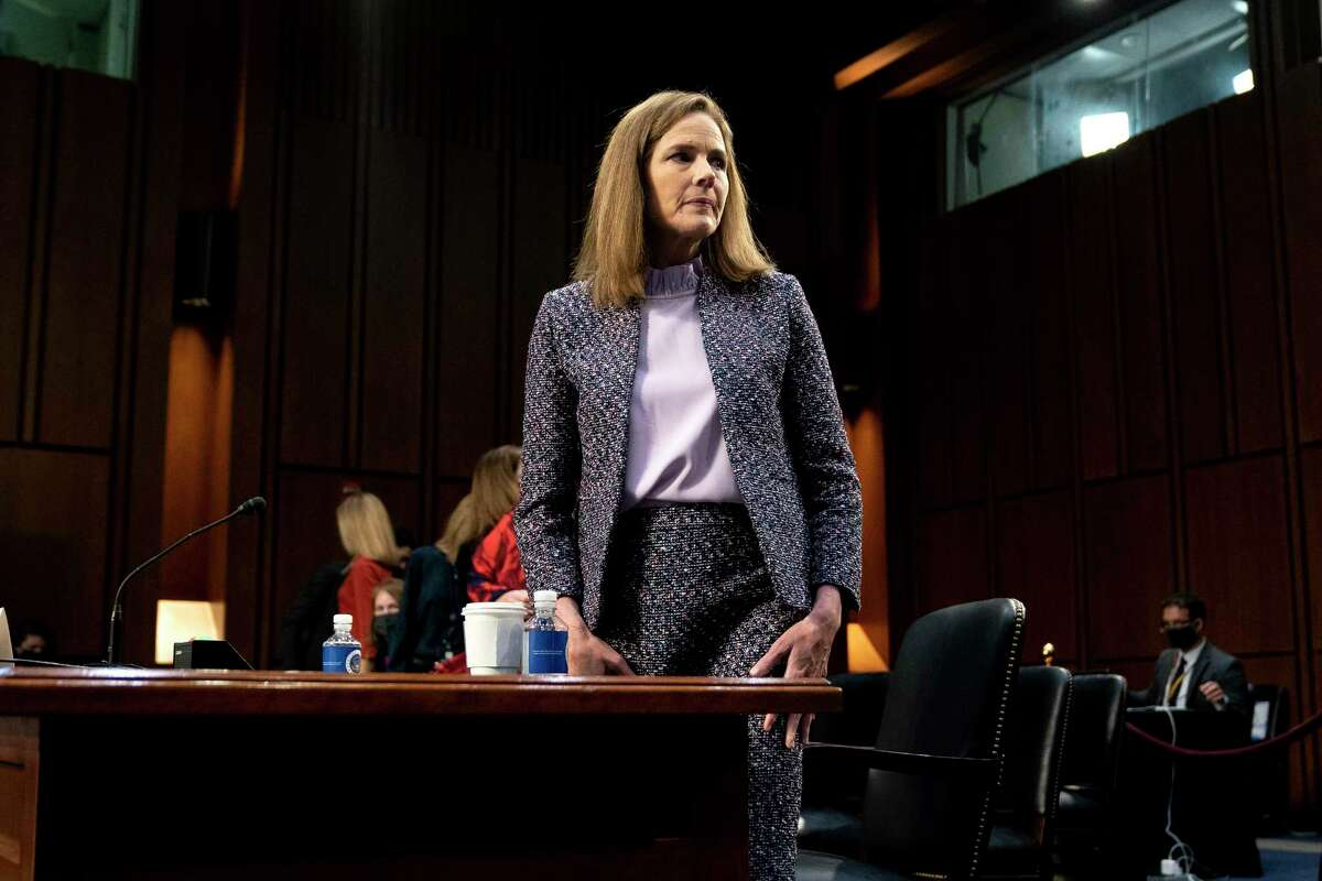 In this Wednesday, Oct. 14, 2020 file photo, Supreme Court nominee Amy Coney Barrett departs during a break in a confirmation hearing before the Senate Judiciary Committee on Capitol Hill in Washington. (Stefani Reynolds/Pool via AP)