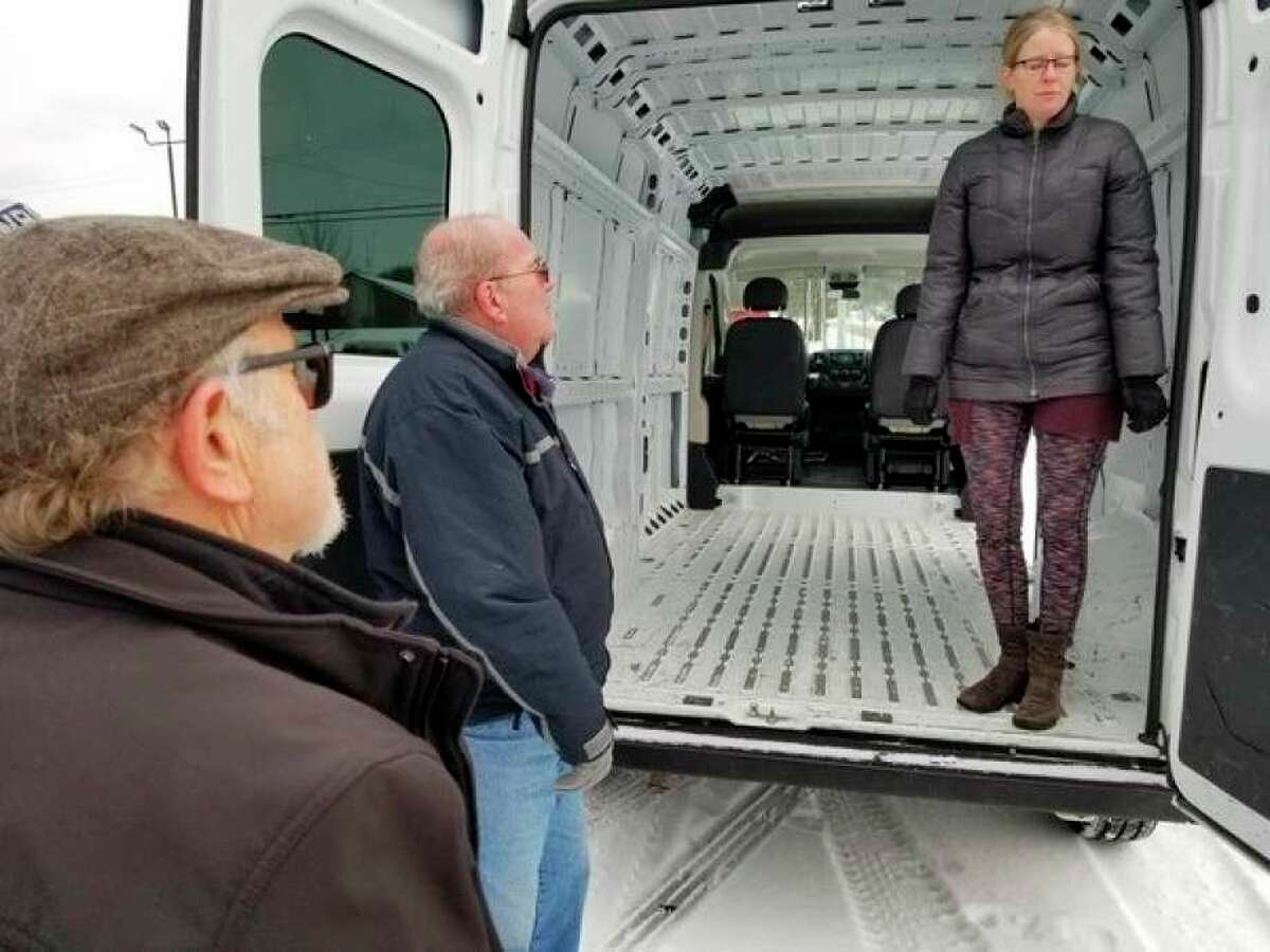 Members of the Betsie Valley Community Center along with dental hygienist, Jennifer Kerns inspects a van in 2019. The van has been converted into a mobile medical lab that will provide dental services to local children. (Courtesy Photo)