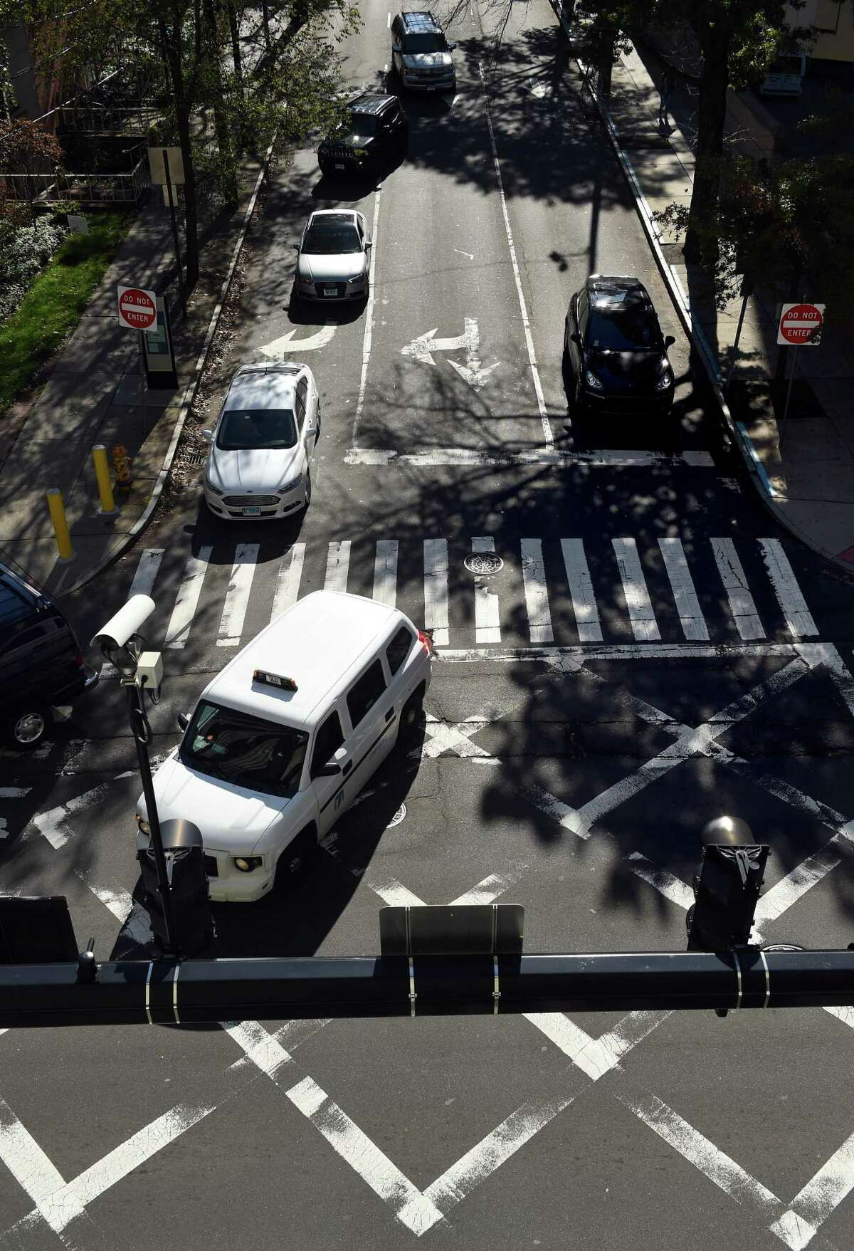 Vehicles travel on York Street in New Haven through the intersection with South Frontage Road on Wednesday.